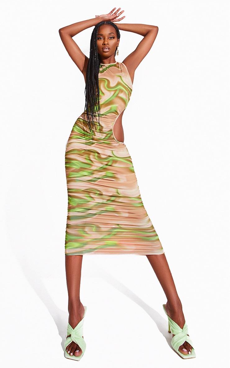 Robe mi-longue imprimée verte à découpes froncée 1