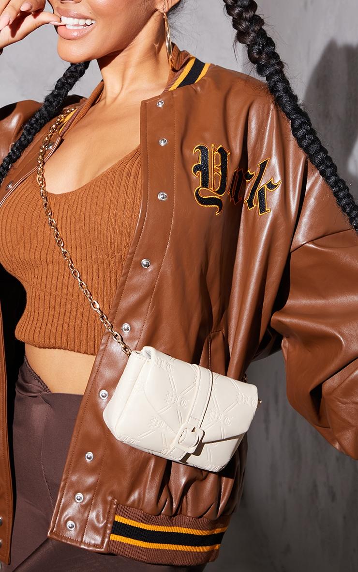 PRETTYLITTLETHING Cream Gothic Embossed Mini Cross Body Bag 1