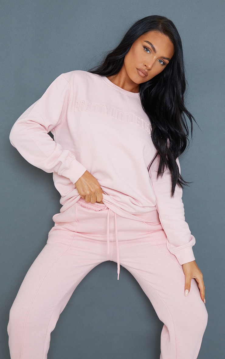 PRETTYLITTLETHING Baby Pink Embossed Sweatshirt 1