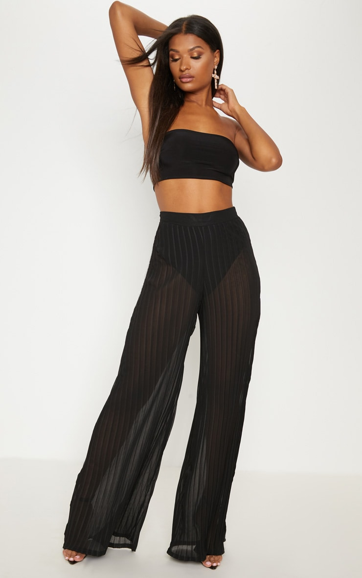 Pantalon ample noir plissé transparent