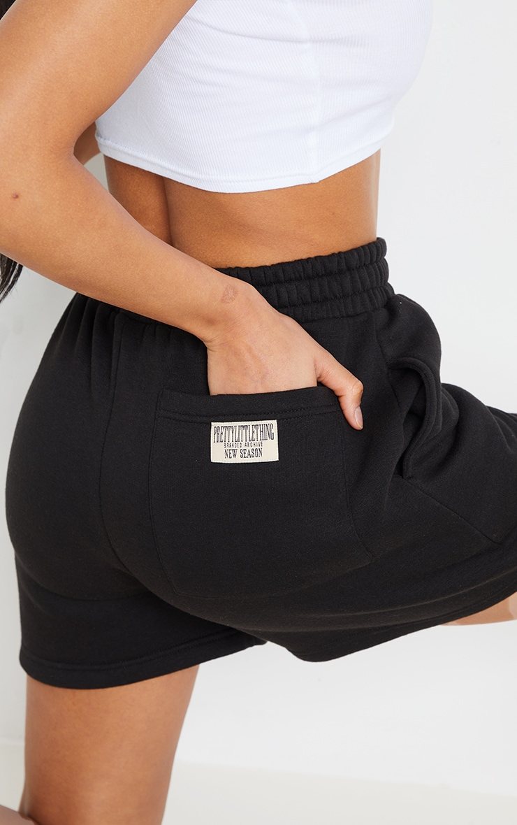 PRETTYLITTLETHING Black Badge Bum Pocket Runner Shorts 5