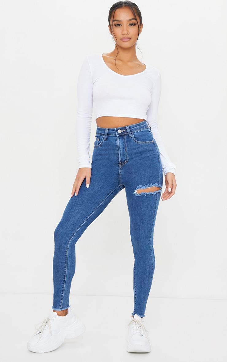 PRETTYLITTLETHING Petite Mid Blue Thigh Rip Raw Hem 5 Pocket Skinny Jeans 1