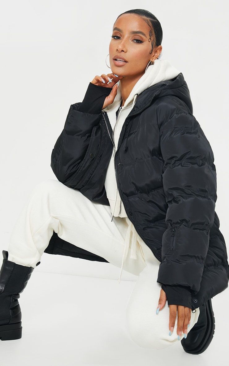 Black Quilted Belted Cuffed Sleeve Puffer Coat. 1