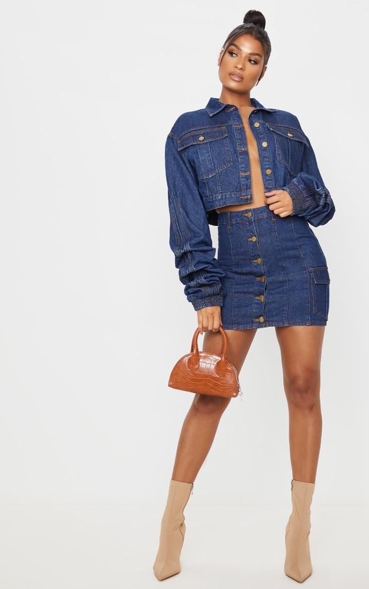 Mini-jupe en jean bleu moyennement délavé 1