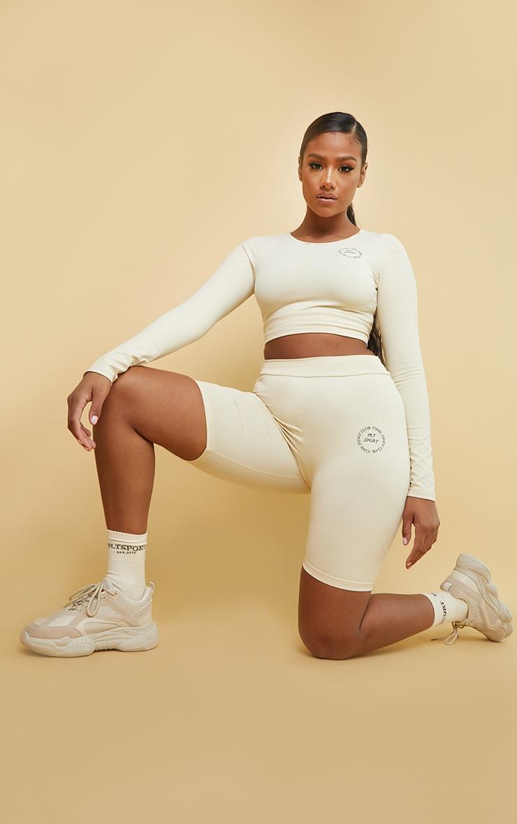 PRETTYLITTLETHING Cream Sport Cool Down Ruched Bum Bike Shorts 1