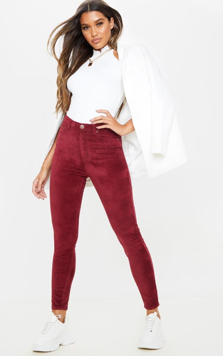 burgundy-velvet-skinny-jeans- by prettylittlething