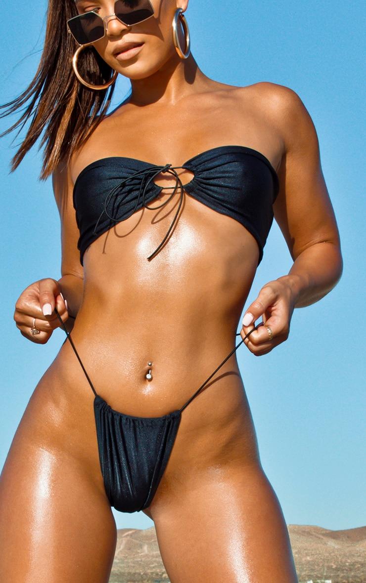 Bas de bikini noir à attaches élastiques 1