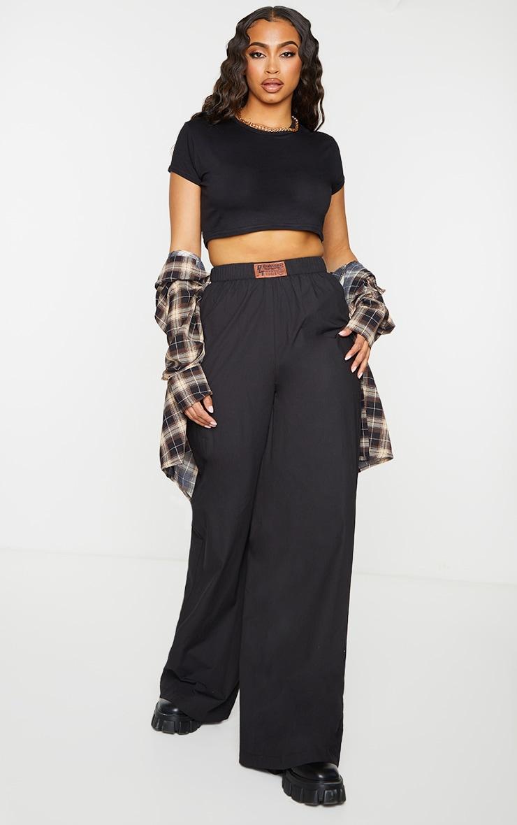 PRETTYLITTLETHING Black Badge Detail Cotton Wide Leg Trousers 1