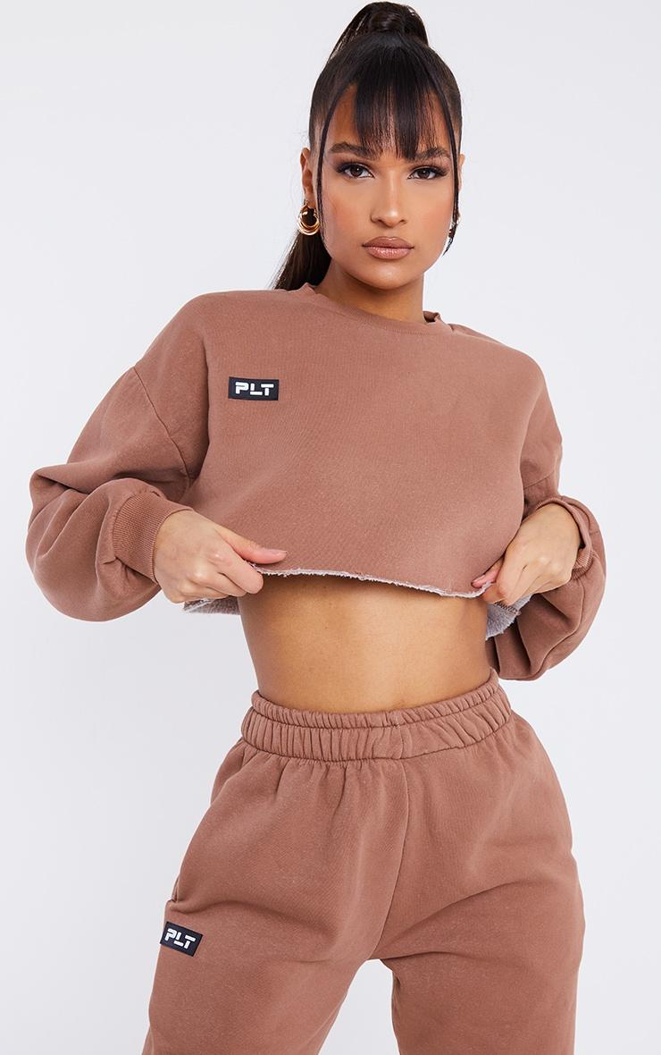 PRETTYLITTLETHING Mocha Washed Badge Detail Cropped Raw Hem Oversized Sweater 1