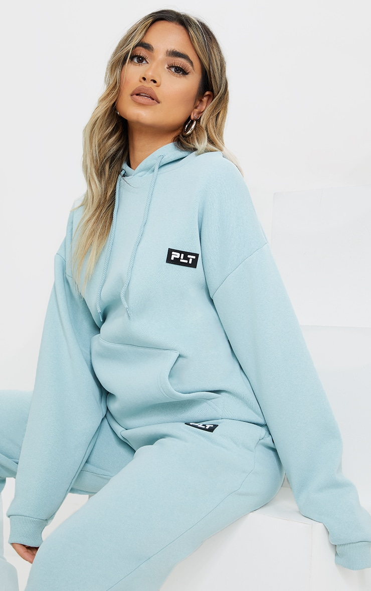 PRETTYLITTLETHING Petite Sage Blue Badge Detail Oversized Hoodie 1