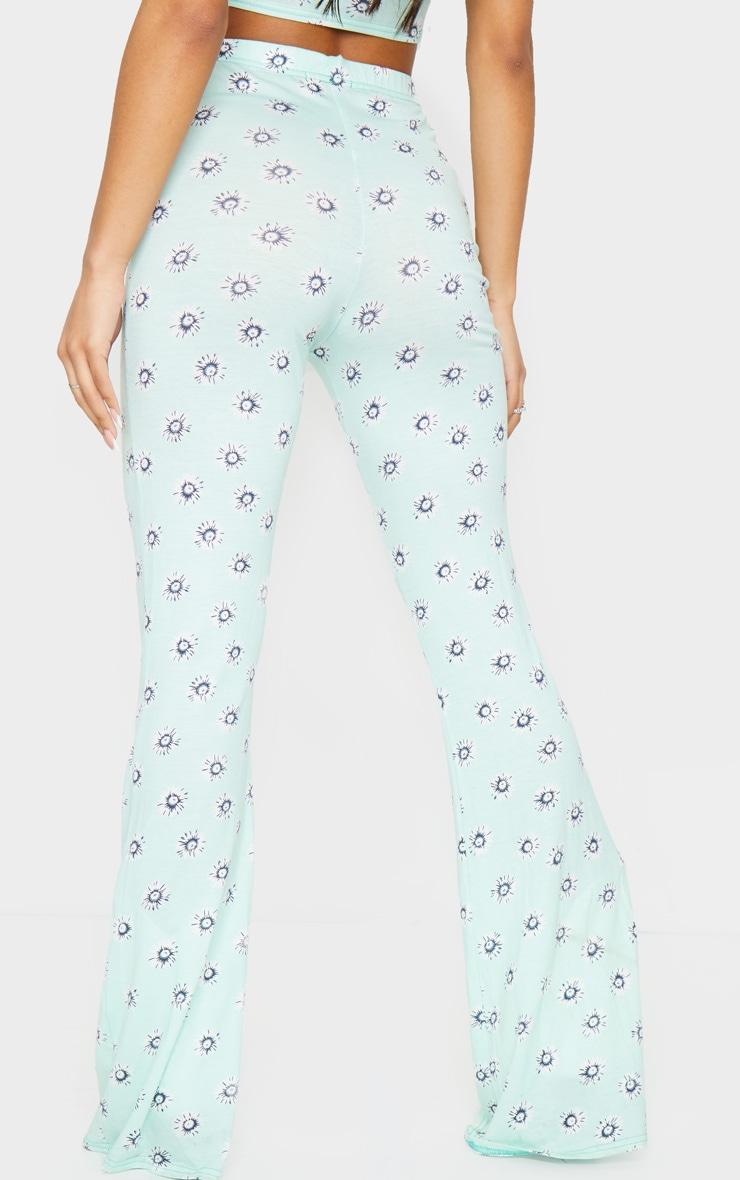 Pantalon en jersey menthe imprimé pâquerettes à taille haute et jambes évasées 3