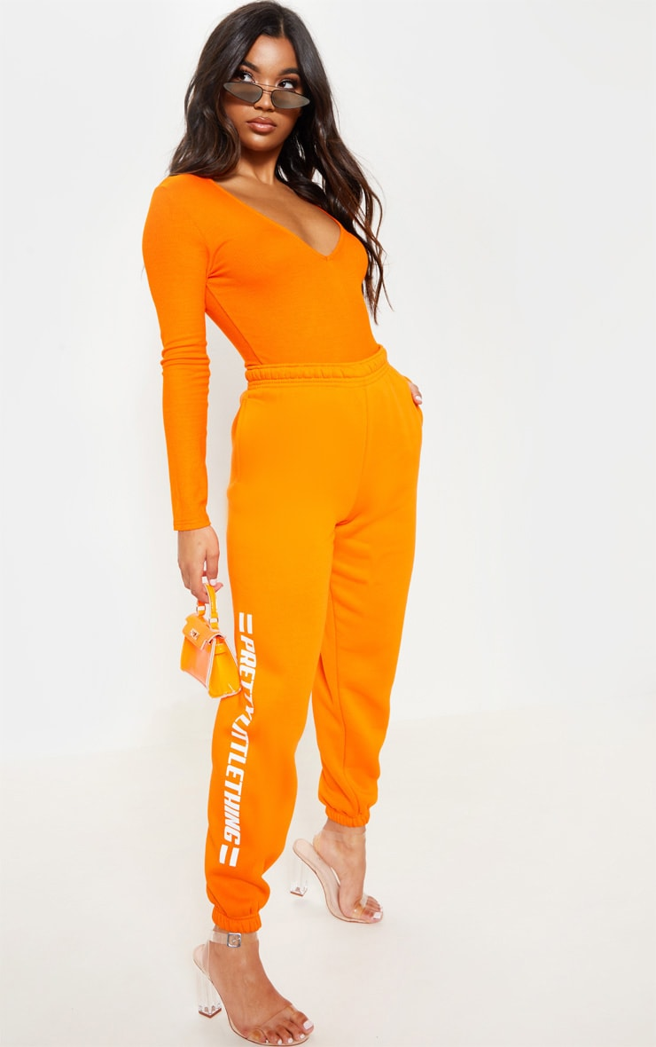 PRETTYLITTLETHING Bright Orange Logo Stripe Jogger 1