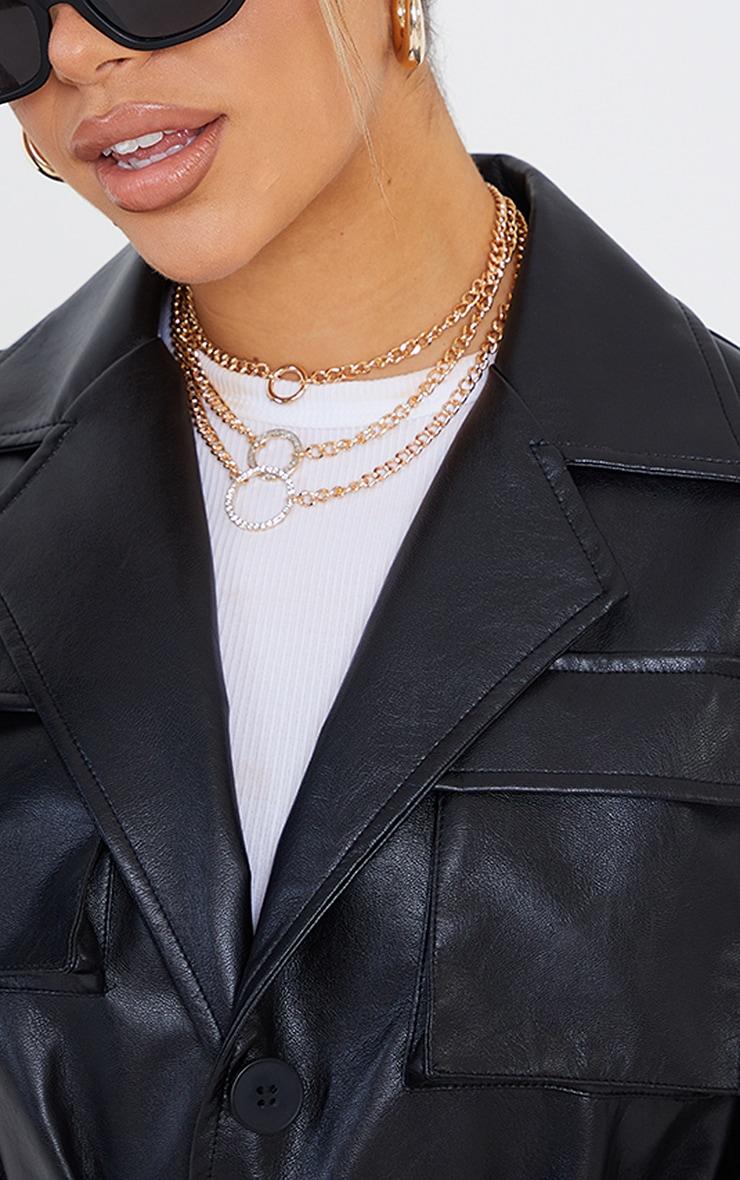 Collier doré à triple chaînes, anneaux et strass 2