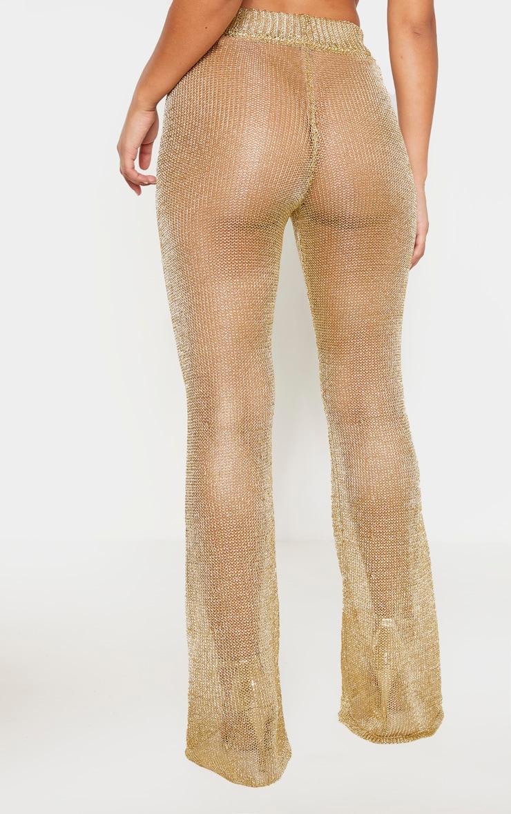 Pantalon flare en maille métallisée dorée 4