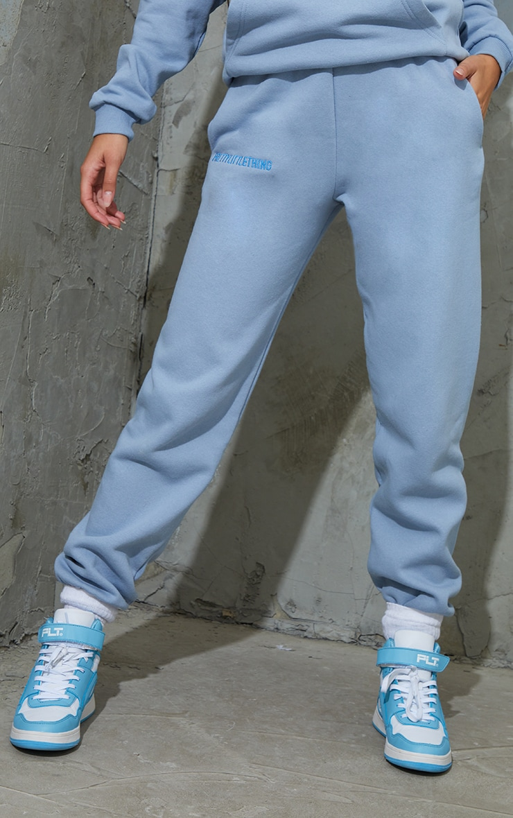 PRETTYLITTLETHING Dusty Blue Embroidered Slogan Joggers 2