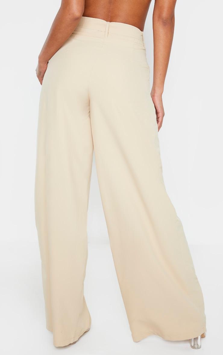 Pantalon en maille gris pierre à jambes évasées et détail ceinture 4