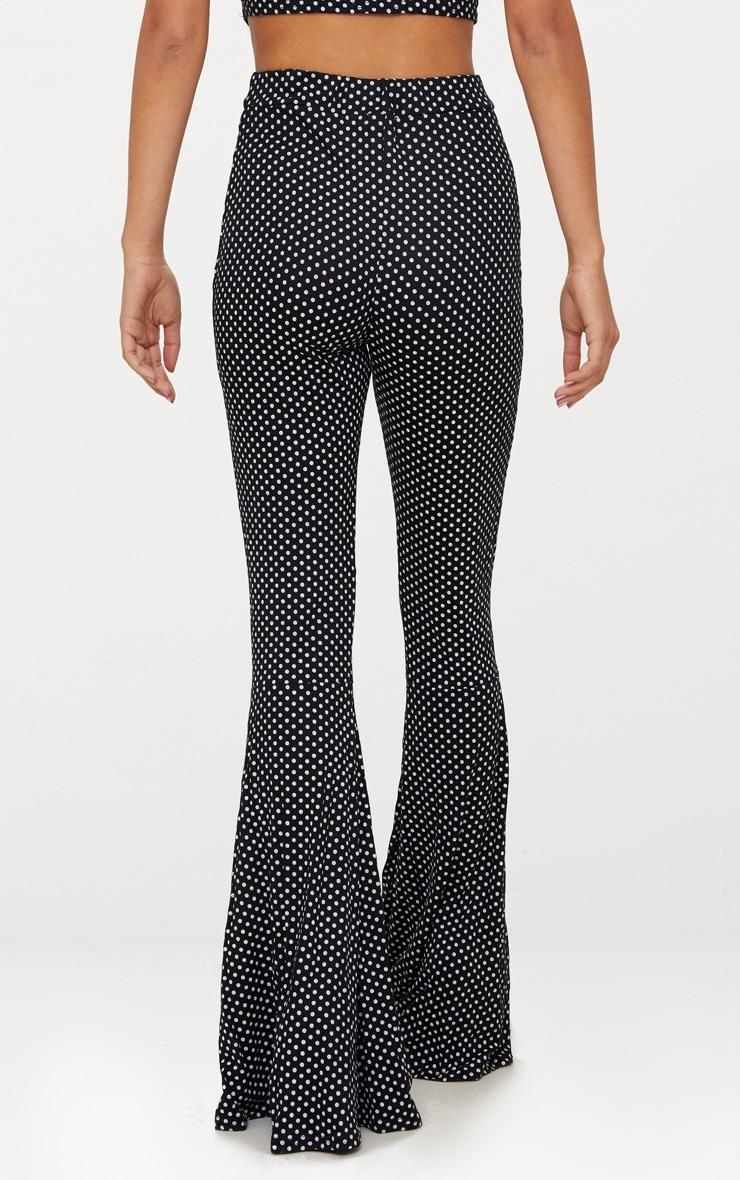 Pantalon flare noir à pois 4