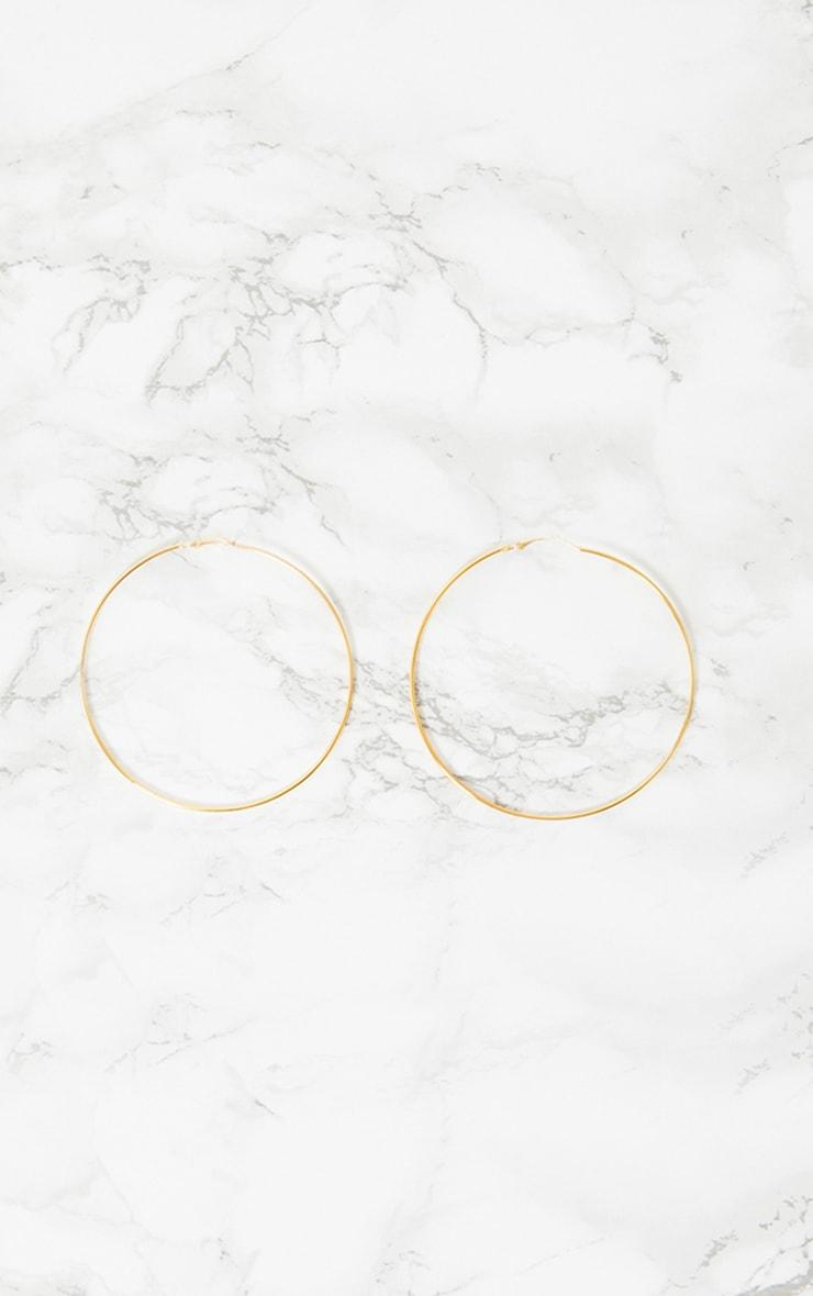 Boucles d'oreilles créoles dorées 3