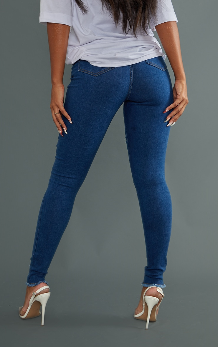 PRETTYLITTLETHING Mid Blue Wash Ripped Hem Jeans 3