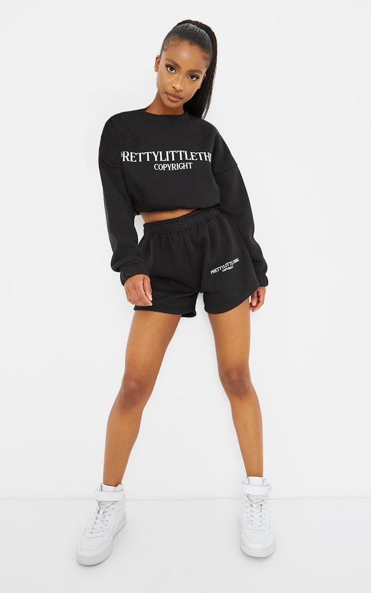 PRETTYLITTLETHING Petite Black Logo Sweat Shorts 1