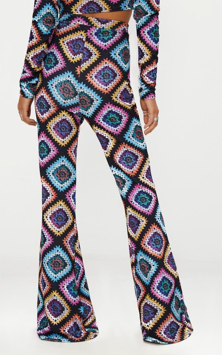 Black Printed Crochet  Flared Trousers 3