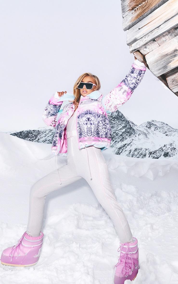 PRETTYLITTLETHING - Combinaison de ski rose pastel à imprimé
