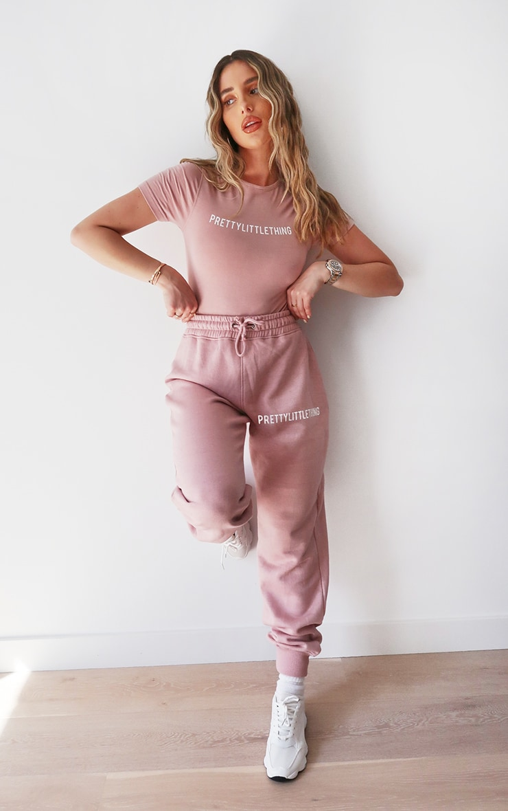 PRETTYLITTLETHING Lilac Embroidered Slogan Joggers 1