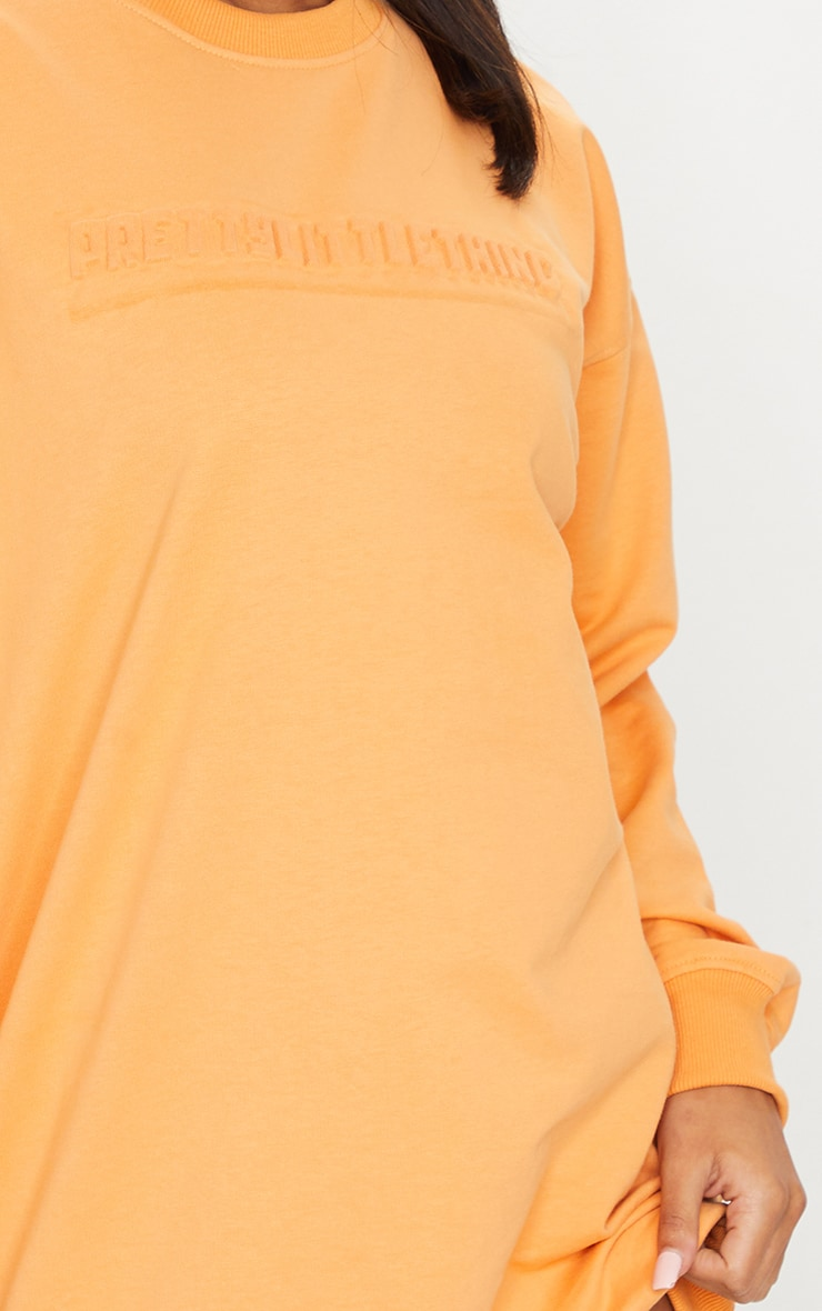 PRETTYLITTLETHING Orange Embossed Slogan Sweat Jumper Dress 4