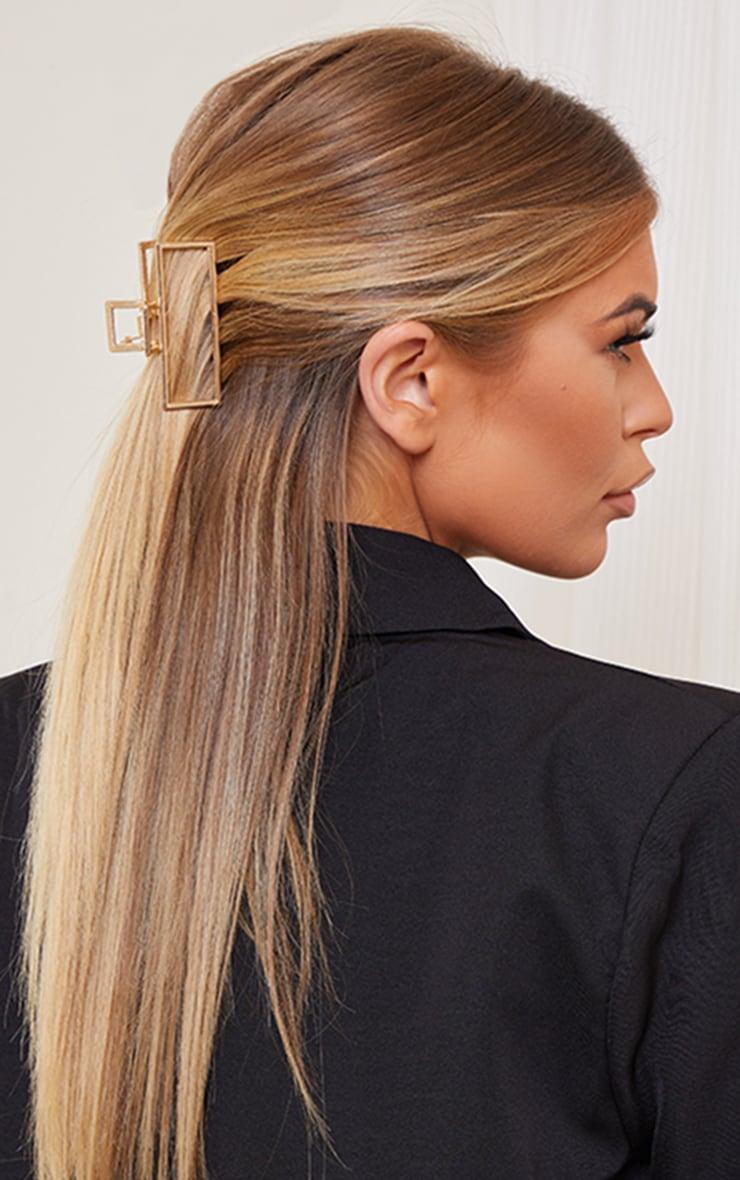 Pince à cheveux dorée rectangle découpée  2