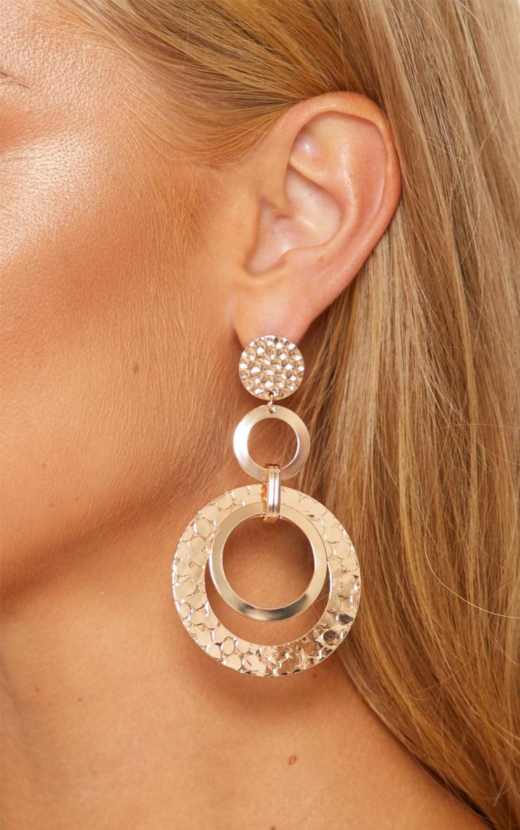 Boucles d'oreilles pendantes dorées texturées