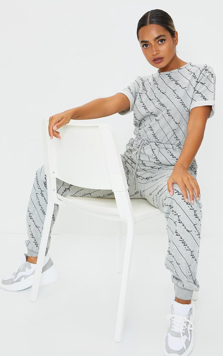 PRETTYLITTLETHING Petite Grey Short Sleeve Sweat Jumpsuit 1