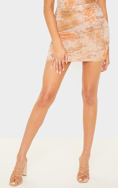 Nude Oriental Mesh Printed Mini Skirt