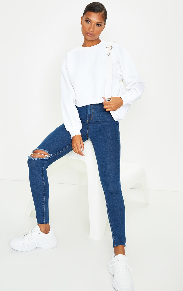 PRETTYLITTLETHING Mid Blue Wash Raw Hem Knee Rip Disco Skinny Jeans 1