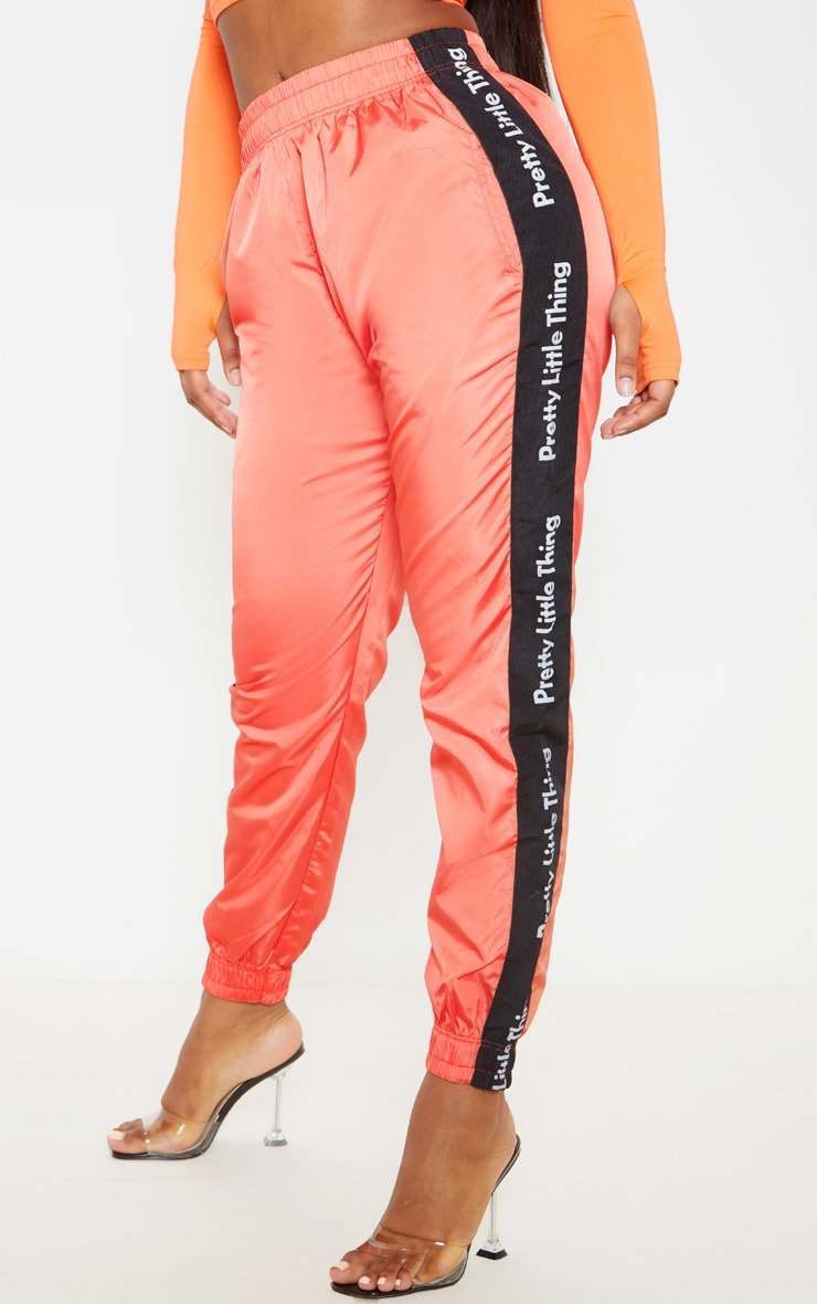 PRETTYLITTLETHING Orange Side Tape Shell Jogger 2