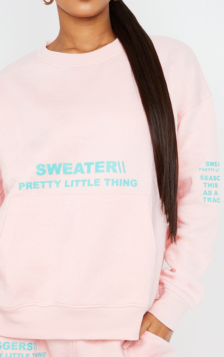 PRETTYLITTLETHING Light Pink Oversized Graphic Print Pocket Front Sweater 4