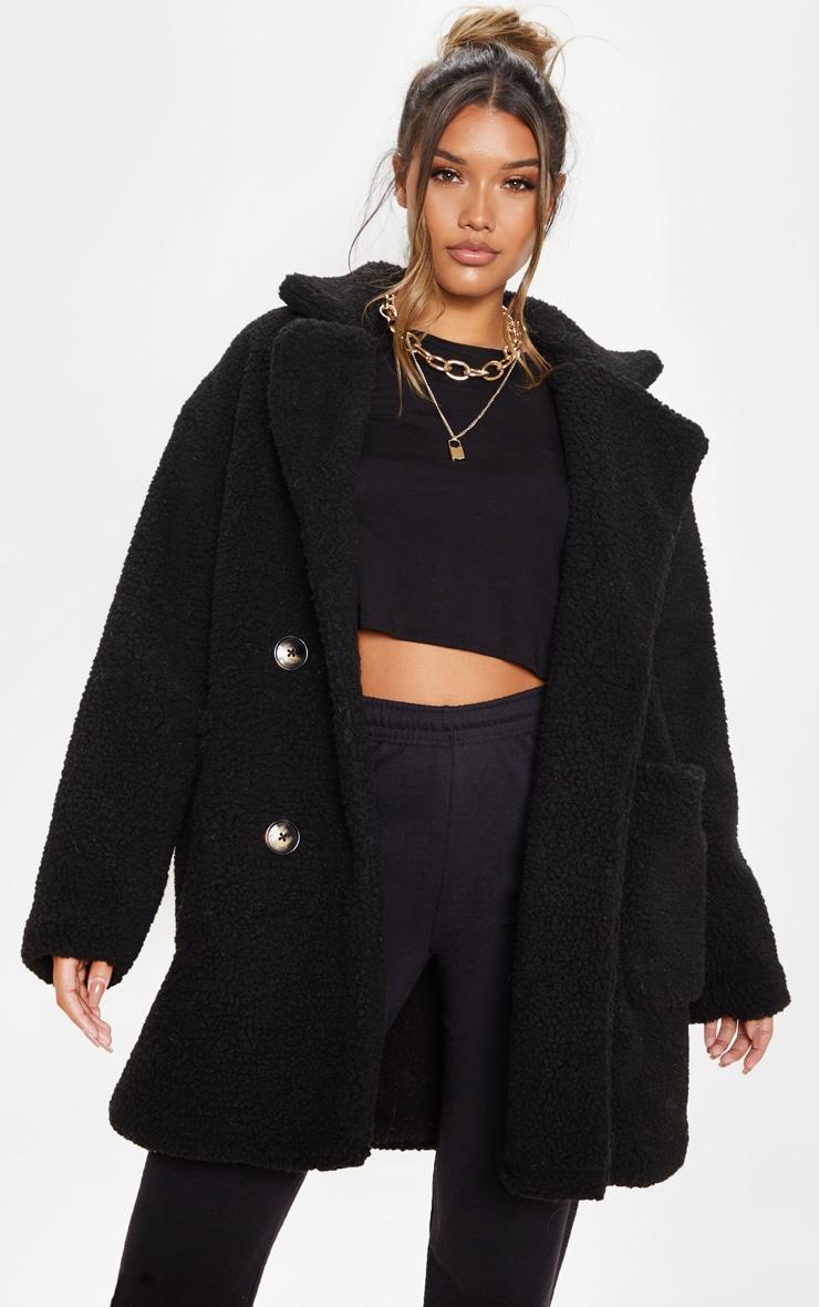 Manteau noir imitation peau mouton | PrettyLittleThing FR