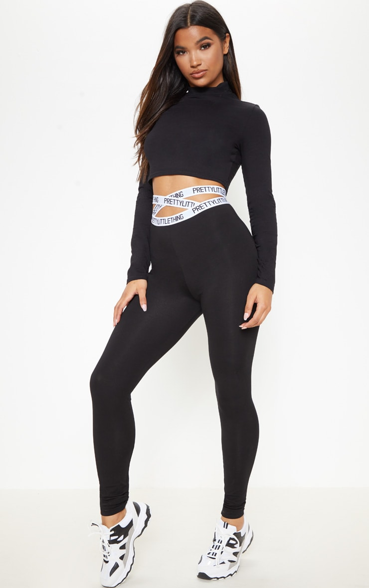 PRETTYLITTLETHING Black Strappy Waist Leggings 1