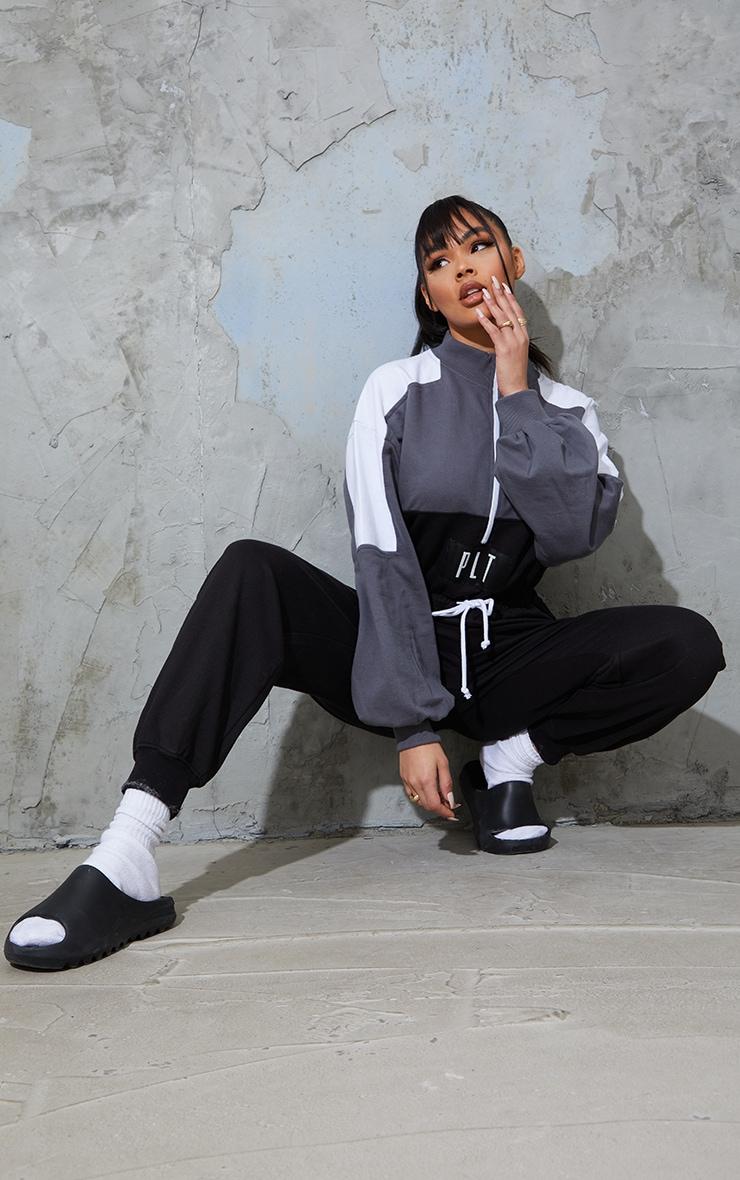 PRETTYLITTLETHING Black Color Block Zip Sweat Jumpsuit 1
