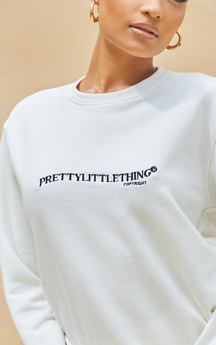 PRETTYLITTLETHING Cream Copyright Embroidered Sweater 4
