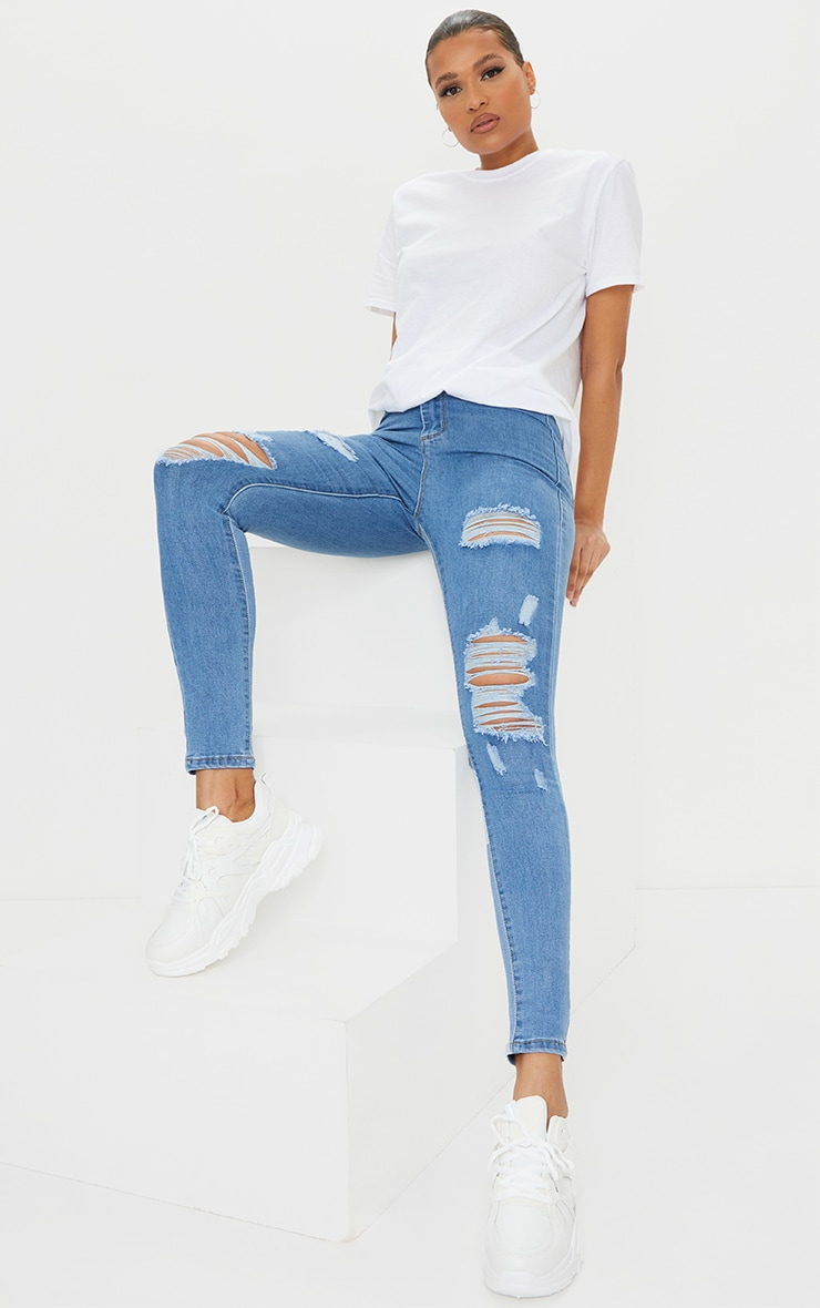 PRETTYLITTLETHING Light Wash Distressed Disco Skinny Jean 1