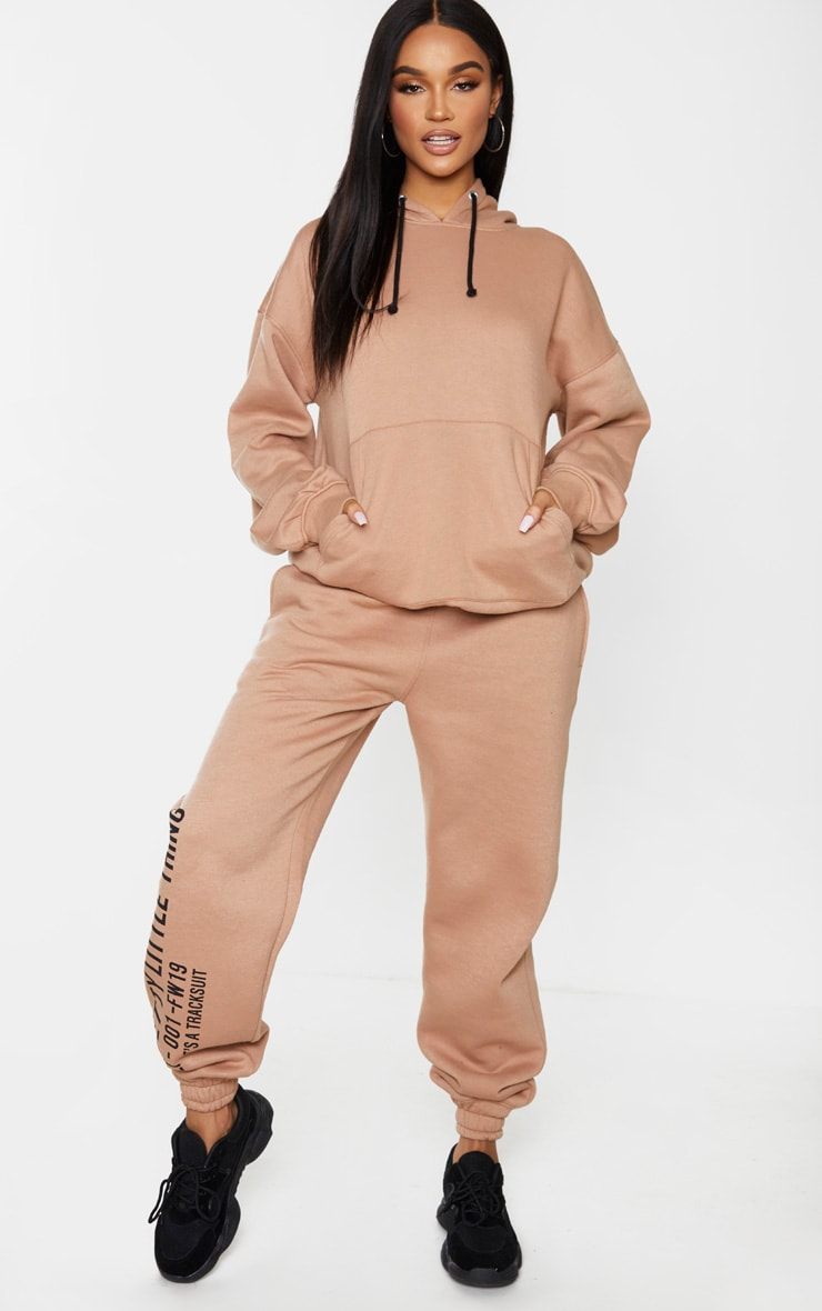 PRETTYLITTLETHING Mocha Oversized Slogan Back Pocket Front Hoodie 3