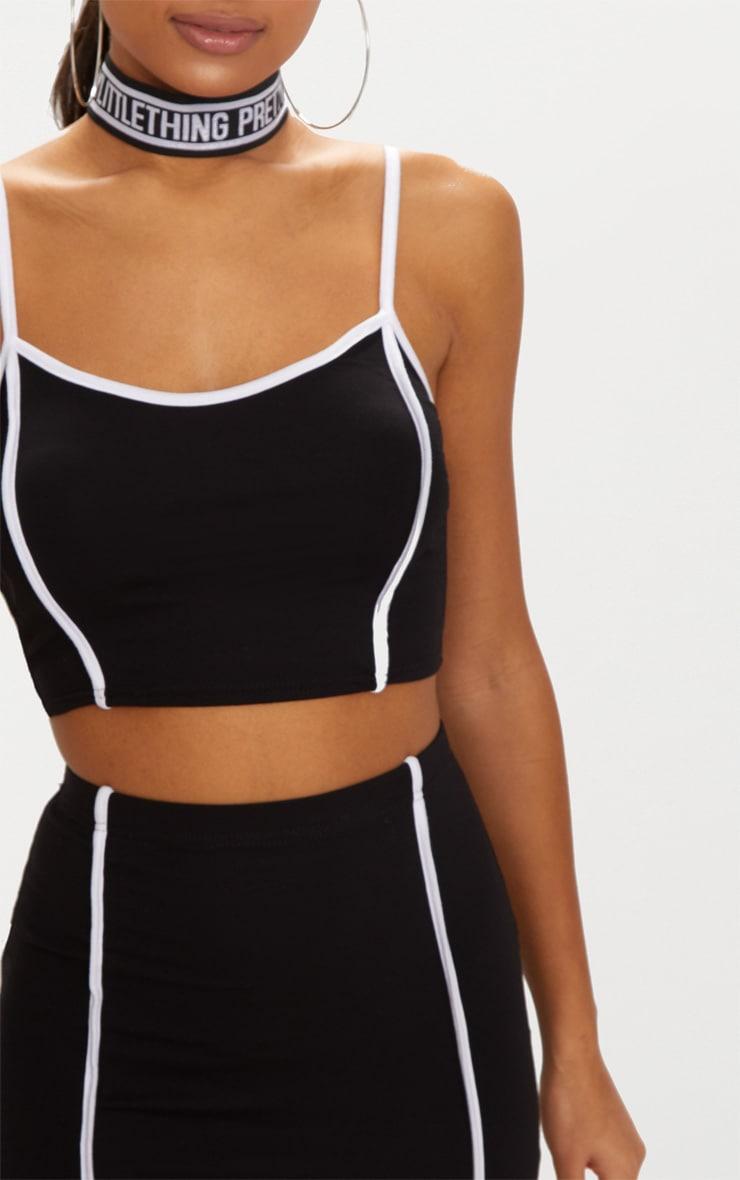 Crop top noir à bretelles et coutures blanches  5