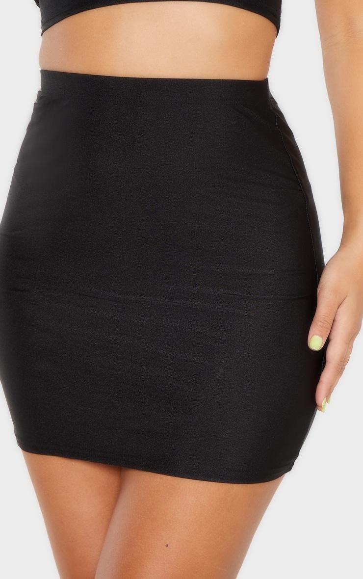 Mini-jupe disco noire 6