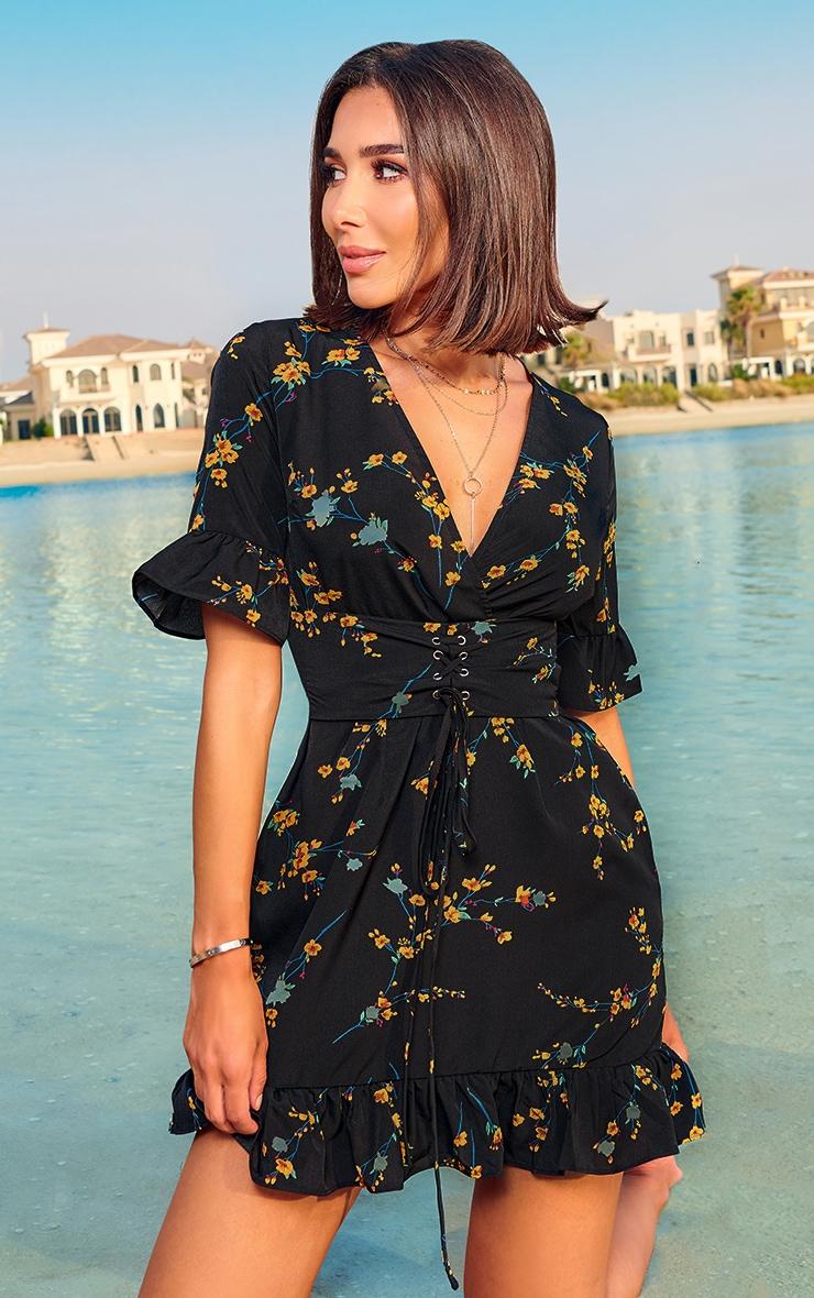 Robe trapèze noire à imprimé floral et corset  1