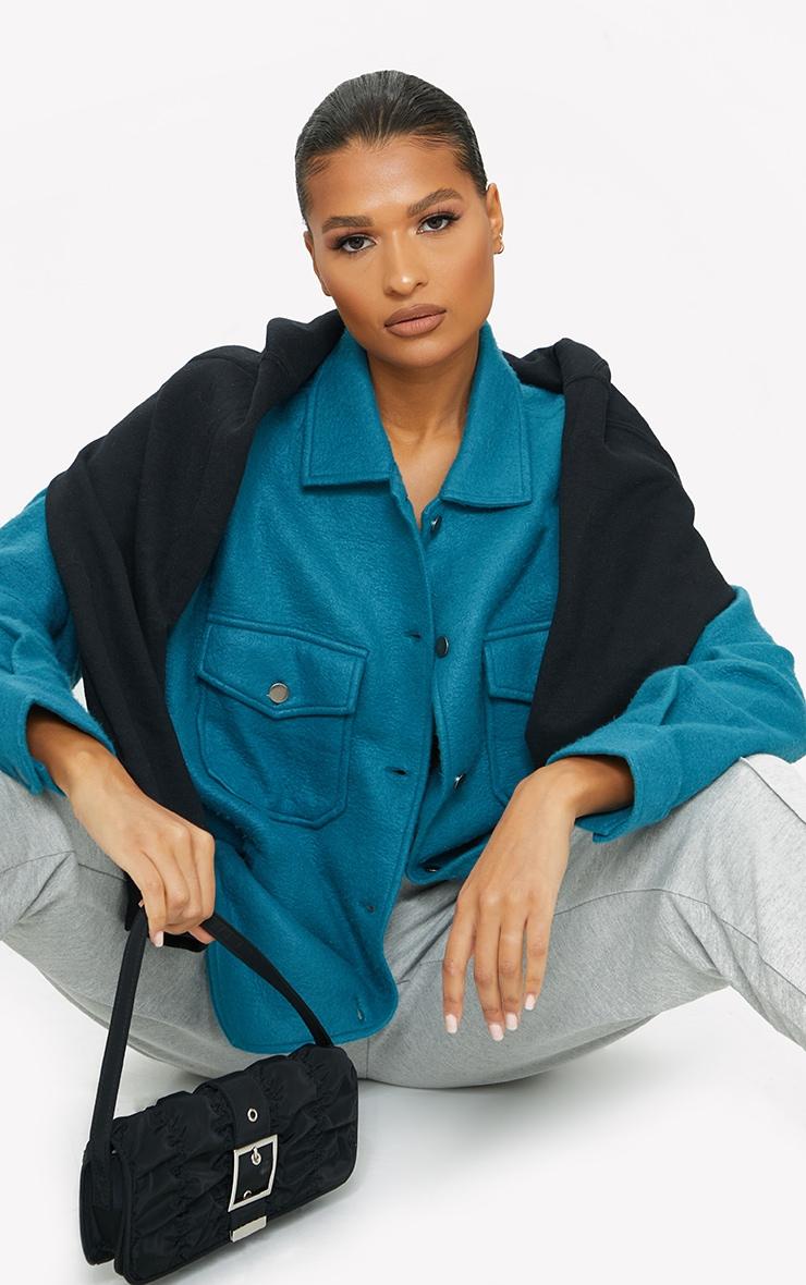 Veste style chemise bleu sarcelle à poches devant 4
