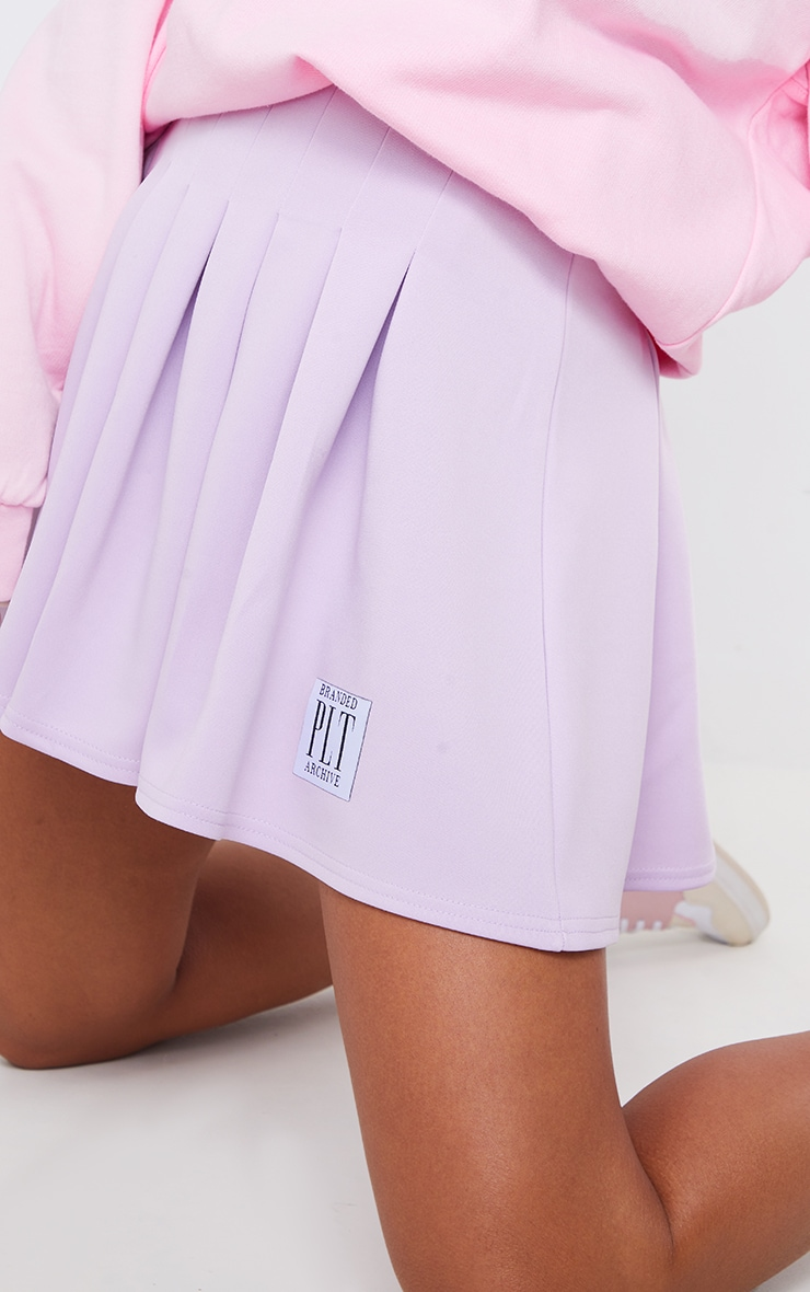 PRETTYLITTLETHING Lilac Badge Pleated Skater Skirt 5