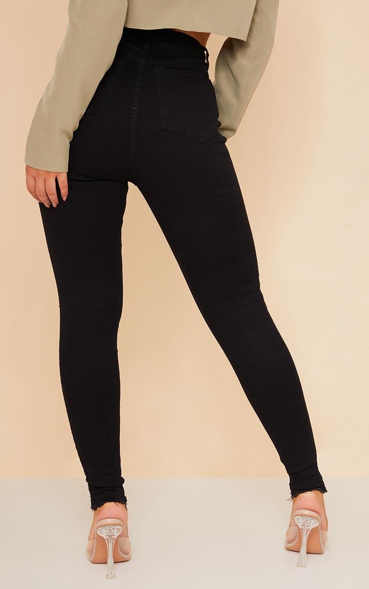 PRETTYLITTLETHING Black Ripped Hem Jeans 3
