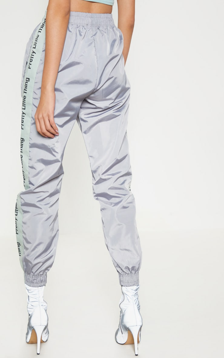 PRETTYLITTLETHING Silver Side Tape Shell Jogger 4