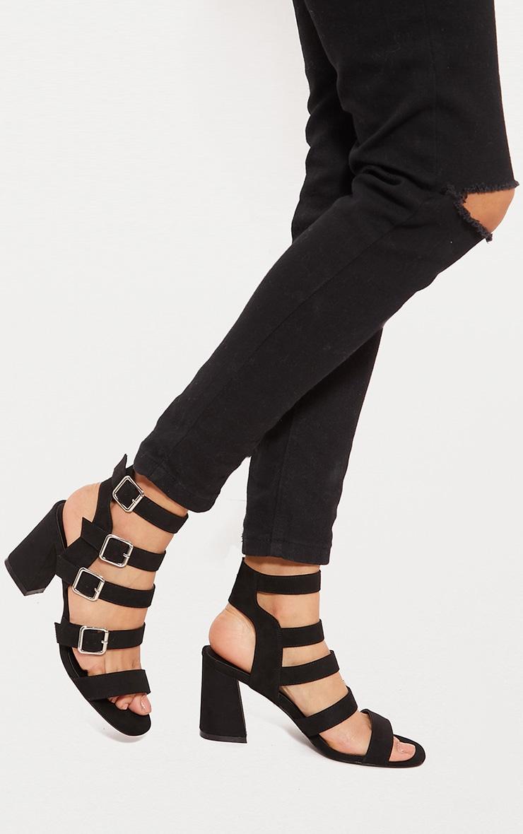 Sandales noires à brides, boucles et gros talons 1