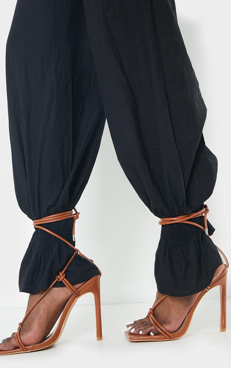 Pantalon noir en maille tissée à boutons et ourlet froncé  4